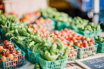 Various fruits and vegetables in baskets in shop counters - AAAF